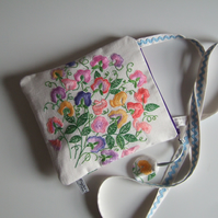 Sweet pea vintage embroidery across your body occasions bag.