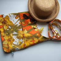 Bold 1970's orange and yellow vintage barkweave print, across your body bag.