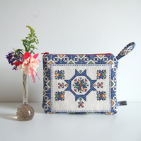 Geometric embroidered zip up purse, make up, or man bag