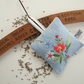 Blue linen lavender bag with vintage embroidery and dried Yorkshire lavender.