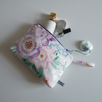 Toiletries, make up or clutch bag made from  vintage hand embroidery.