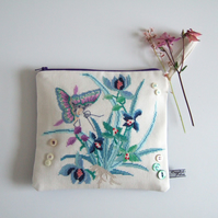 Zipped pouch made from a vintage embroidery butterfly and flowers design.