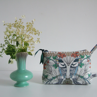 Toiletries or make up bag with an exotic bird print design