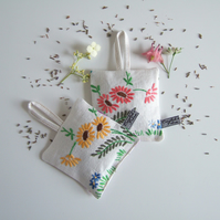 A pair of lavender bags with vintage floral embroidery