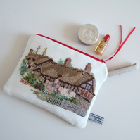 Make-up bag with vintage cross stitch thatched cottage and garden.