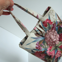 Small bucket bag made from a 1980's vintage floral fabric with carnations.