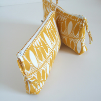Toiletries or make up bag in bold hand printed yellow fabric.