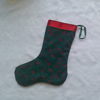 Green and red holly leaf Christmas stocking