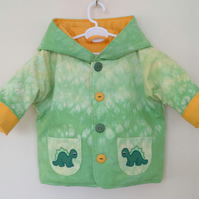 Tie Dye quilted hooded jacket with dinosaur applique