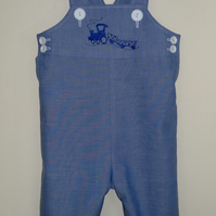 Long dungarees with train embroidery