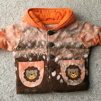 Tie Dye quilted hooded jacket with lion applique.