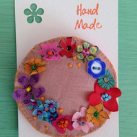 Pink flowery wreath brooch