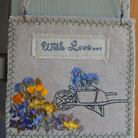 Wheel Barrow and pressed wild flowers - fabric hanger
