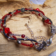 Red black and silver woven bracelet (B 33)