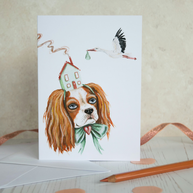 New baby note card featuring a Cavalier King Charles spaniel dog with a stork