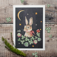 A5 mini print of a rabbit nestled in clover in the starry night