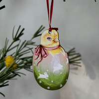 Yellow chick in an Easter egg wooden hanging decoration