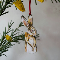 Wooden hare hanging decoration. Wild rabbit