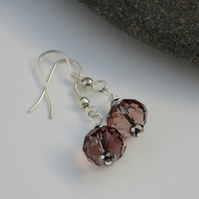 Dusky pink glass earrings with silver.