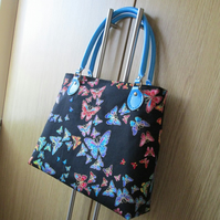 Multicoloured Butterflies on Black Handbag with Leather Handles