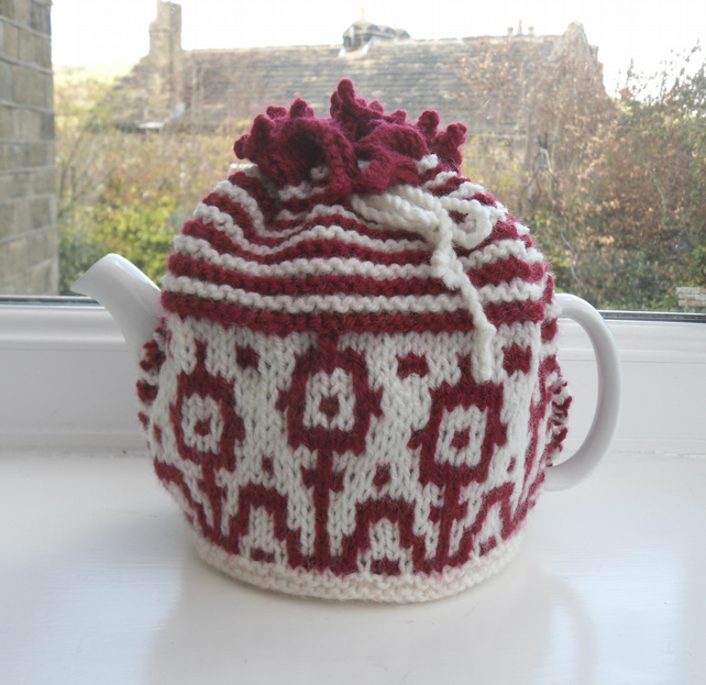 Funky flowery hand knit tea cosy in red and white