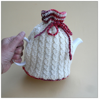 Cream aran hand knit tea cosy