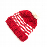 Red and white striiped knitted hat