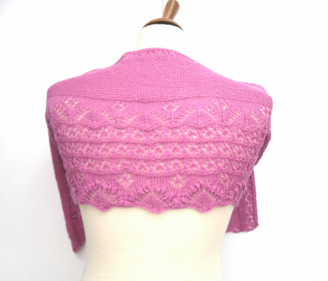 Crescent shaped pink hand knit shawl