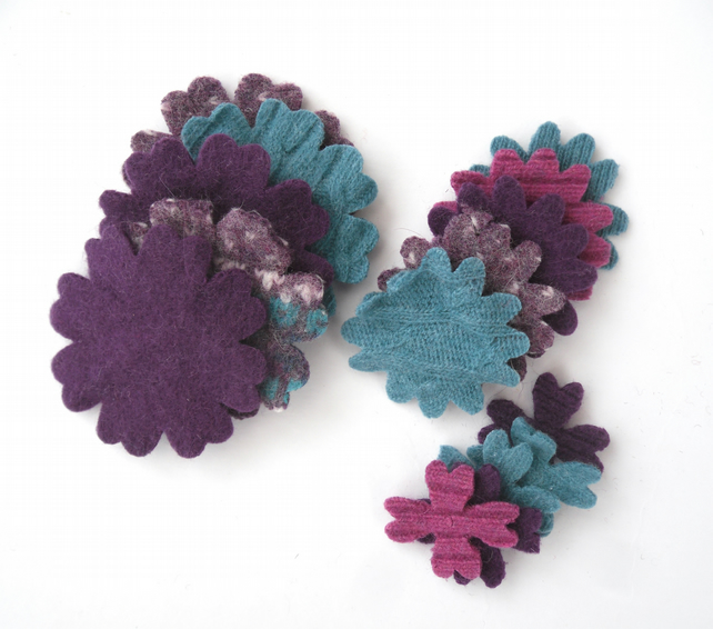 Colourful felt flower shapes made from old recycled wool sweaters