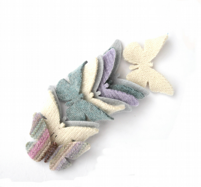 Pastel felt butterfly shapes made from old recycled wool sweaters