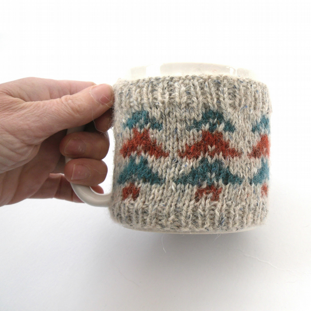 Autumn Mug cosy showing 2 coloured trees , fair isle wool cozy