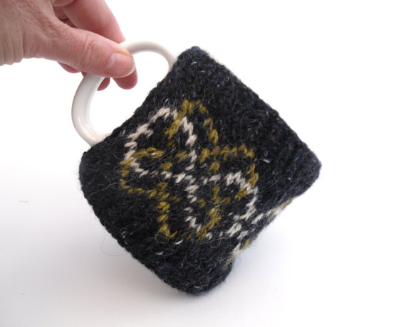 Black wool mug cosy with swirly pattern