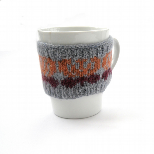 Butterfly mug cosy hand knit in Rowan tweed wool , 10% of sales to Breast Cancer