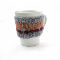 Butterfly mug cosy hand knit in Rowan tweed wool