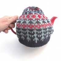 Colourful hand knit tea cosy