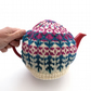 Colourful knitted tea cosy