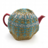 Green knitted tea cosy