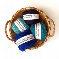 4 balls of blue mohair boucle yarn