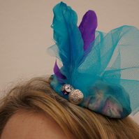 Blue and purple silk and feather fascinator
