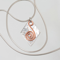 Textured Silver Lozenge Pendant with Copper Spiral SOLD