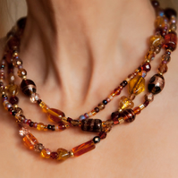 Three-Strand Glass Bead Necklace in Bronze & Amber Colours SOLD