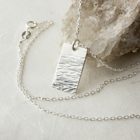 Hammered Silver Pendant with Graduated Waterscape Texture