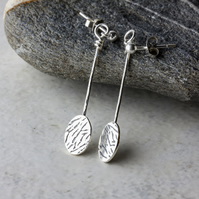 Textured  Silver Long Dangle Oval Disc Earrings with Animal Print Design