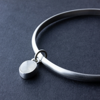 Sterling Silver Bangle with Oval White Moonstone Dangle Charm