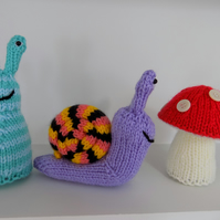 Pdf knitting pattern for baby snail, slug and toadstool toys by Angela Turner