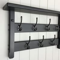 7 Hook hat and coat rack with shelf.