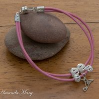 Pink Leather Bracelet with Silver Beads and a Bird Charm