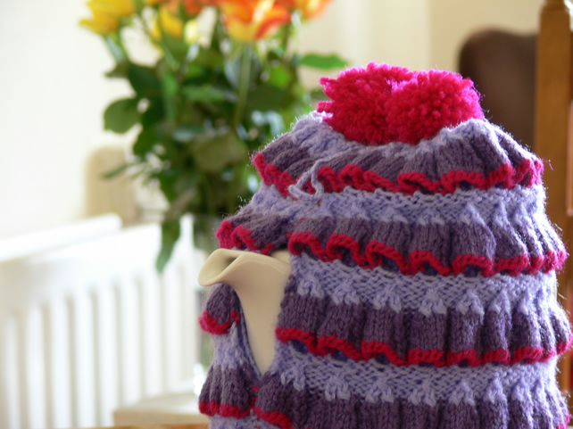 Very Berry hand knitted ruffle tea cosy with pompoms