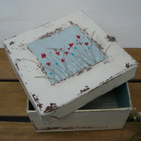 A hand painted gift box meadow scene