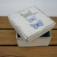A gift box with butterflies